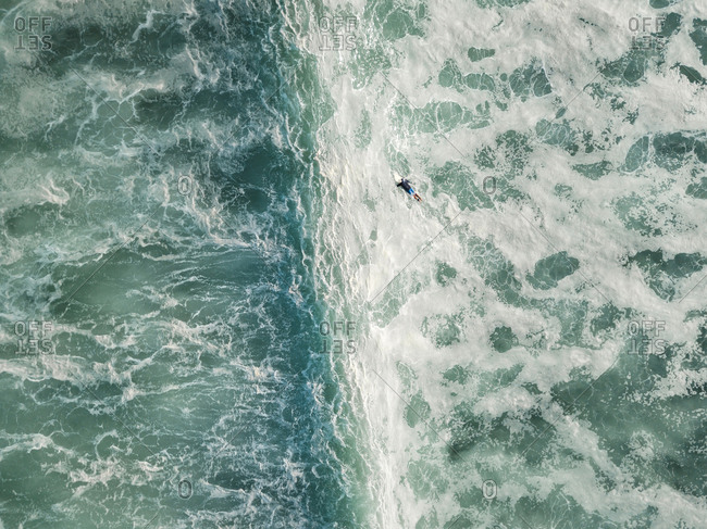 Indonesia- Bali- Aerial view of Balngan beach- surfer