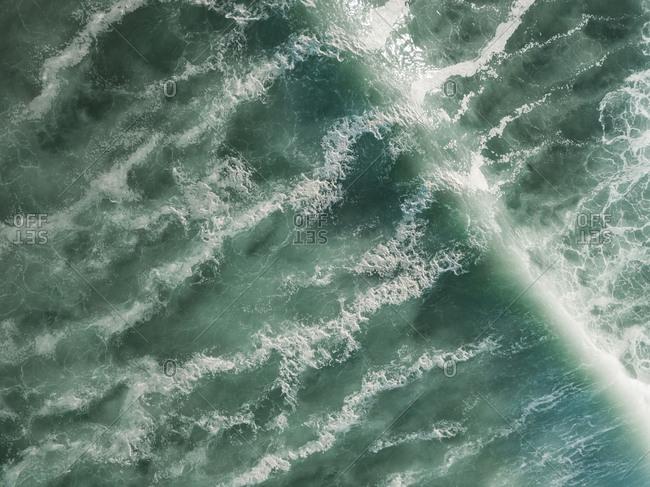 Indonesia- Bali- Aerial view of waves- Balngan beach