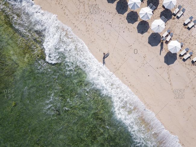 Indonesia- Bali- Aerial view of Balngan beach- surfer at the beach