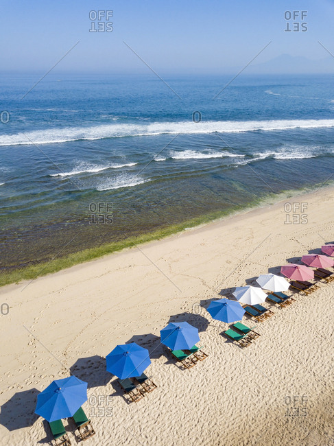 Indonesia- Bali- Aerial view of Balangan beach- sun loungers and beach umbrellas