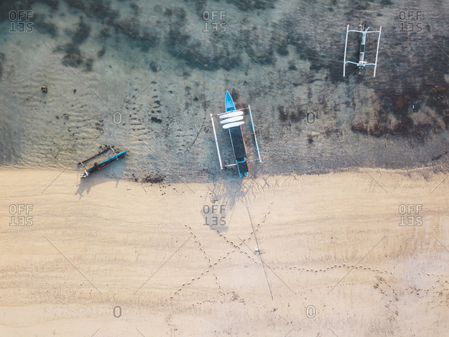 Indonesia- Lombok- Aerial view of banca boat at the beach