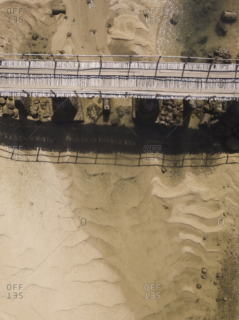 Indonesia- Lombok- Aerial view of old bridge