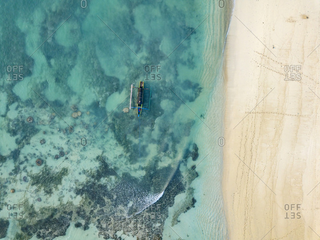 Indonesia- Lombok- Aerial view of beach- banca boat