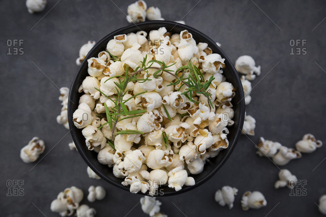 Bowl of popcorn with parmesan and rosemary