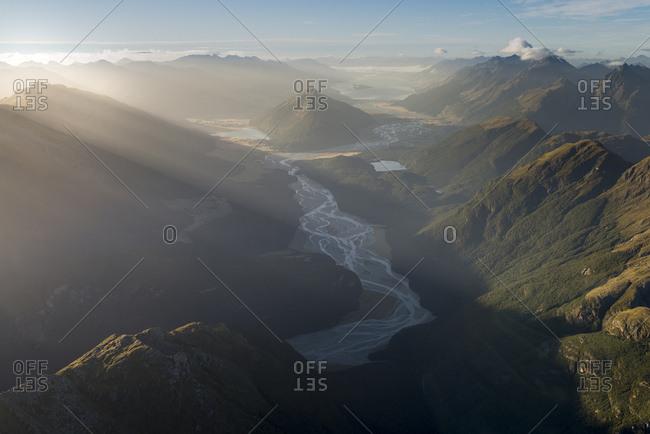 New Zealand- South Island- Otago- Wanaka- Aerial view of Mount Alfred and Lake Wakatipu at sunrise