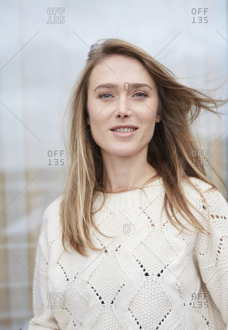 Portrait of woman wearing white knit pullover