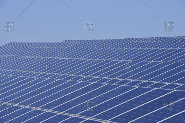 Germany- View of large number of solar panels at solar plant field