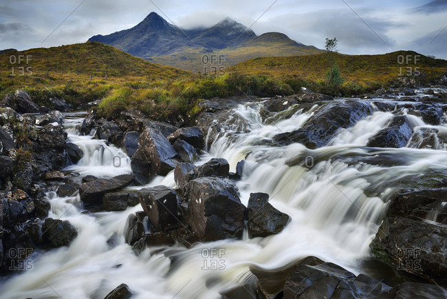 United Kingdom- Scotland- Scottish Highlands- Isle Of Skye- Waterfall at Sligachan river with view to the Cuillin mountains