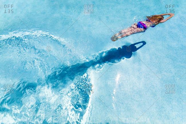 Spain- woman diving in swimming pool