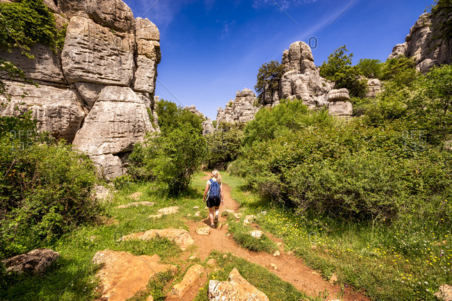 Spain- Malaga Province- El Torcal- woman hiking