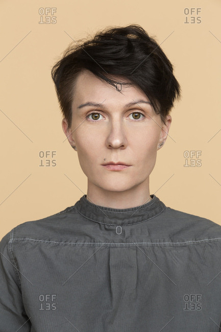 Portrait of serious woman with short hair