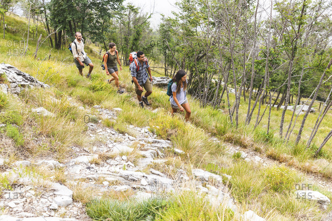 Italy- Massa- group of young people hiking in the Alpi Apuane mountains