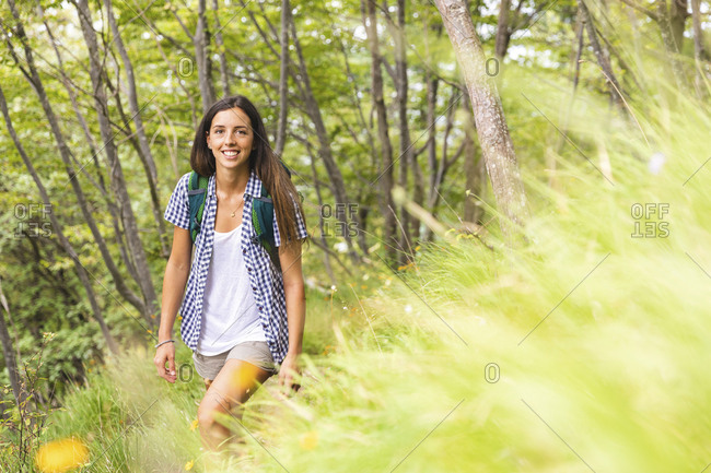 Italy- Massa- smiling young woman hiking in the Alpi Apuane mountains