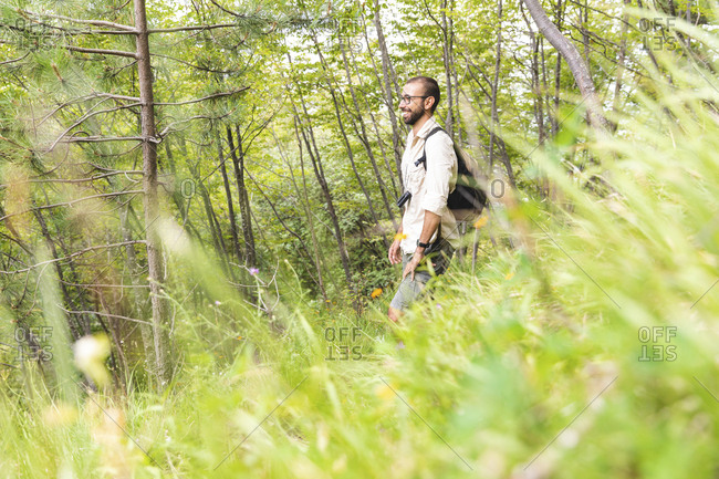 Italy- Massa- smiling man hiking in the Alpi Apuane mountains