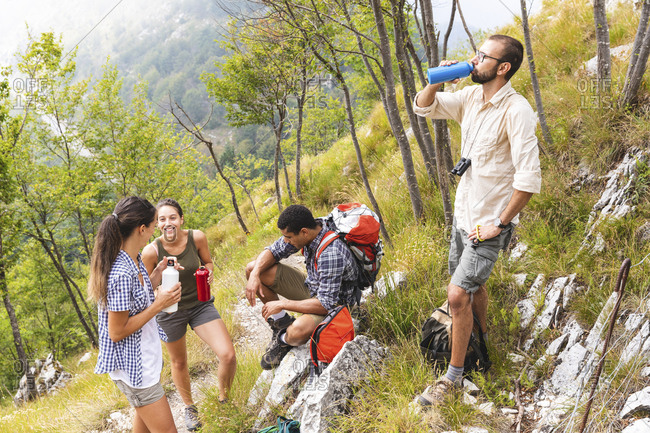 Italy- Massa- hikers taking a rest during a day in the Alpi Apuane mountains