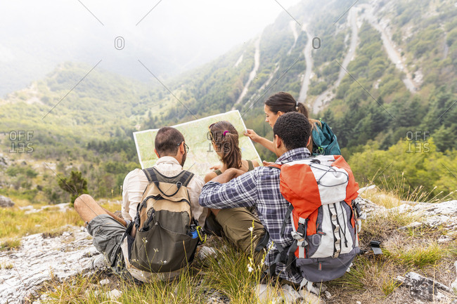 Italy- Massa- group of people hiking and looking at a map in the Alpi Apuane