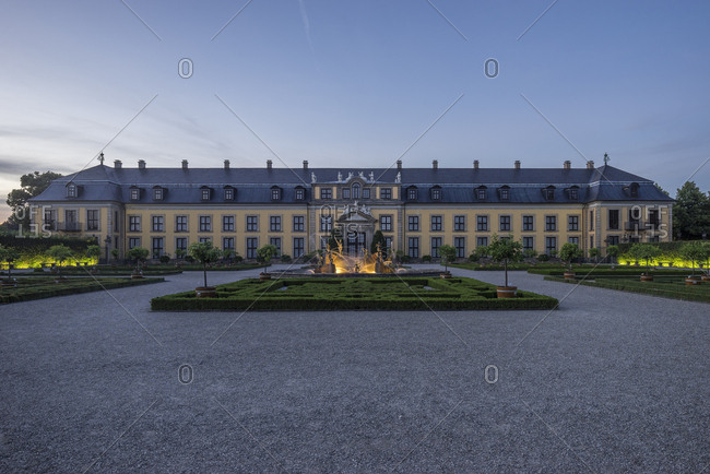 Germany- Lower Saxony- Hanover- Herrenhaeuser Gaerten- Orangenparterre Galery and Neptun Fountain in the evening