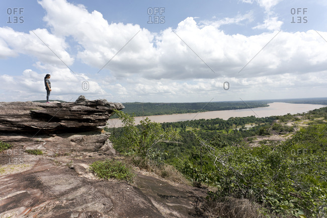 August 3, 2018: Thailand- Ubon Ratchathani Province- Pha Taem National Park- Woman looking to Mekong river- border to Laos