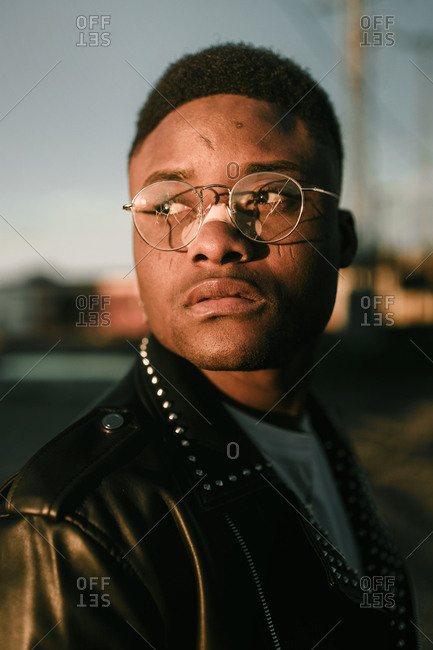 Portrait of young african american man with broken glasses and bandage on his nose