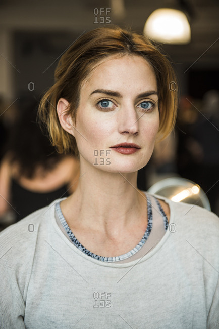 New York City, NY, USA - February 13, 2017: Model backstage having makeup done during the Mara Hoffman fashion show