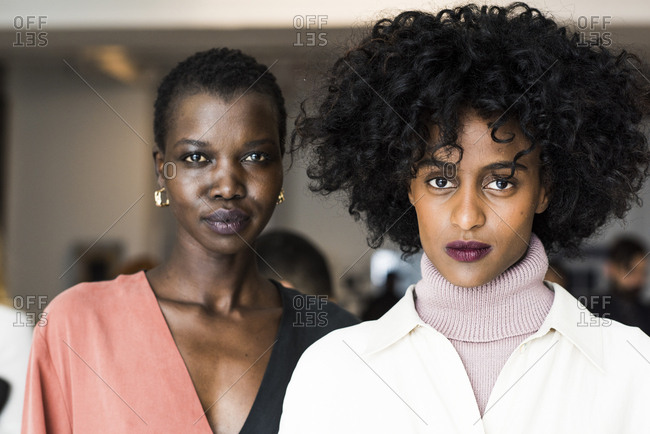 New York City, NY, USA - February 13, 2017: Two models backstage during the Mara Hoffman fashion show