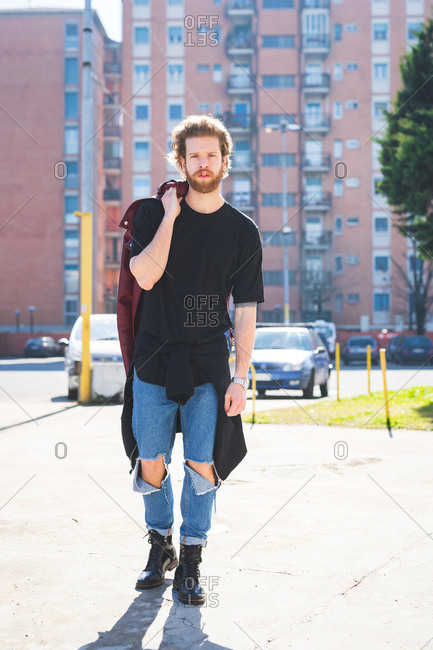 Young bearded man posing outdoor looking camera