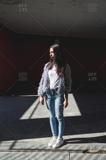 Beautiful young woman posing outdoor looking away