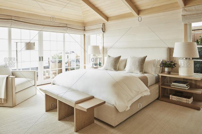 Malibu, California, USA - March 14, 2017: Upscale bedroom in a modern beach house