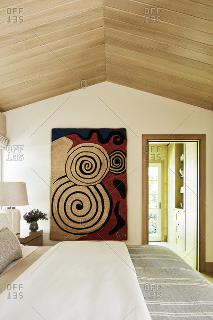 Malibu, California, USA - March 14, 2017: Artwork on bedroom wall in a modern beach house