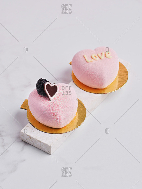 Pair of pink heart-shaped mousse desserts