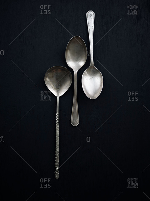 Three spoons on black background