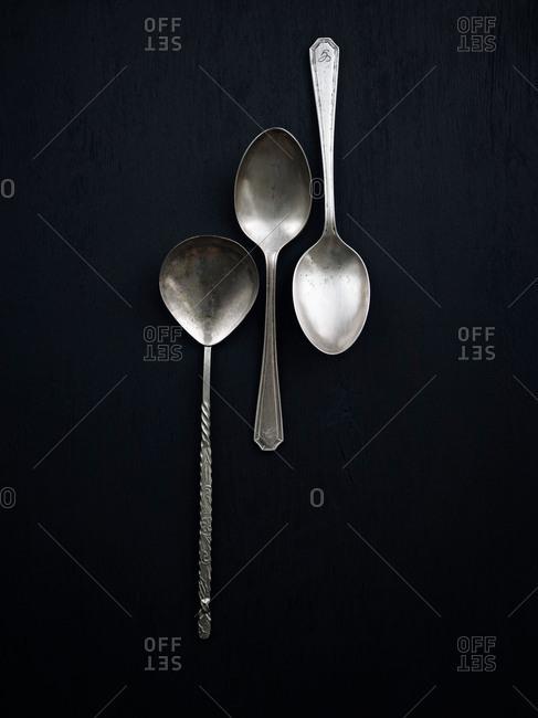 Three spoons on black background