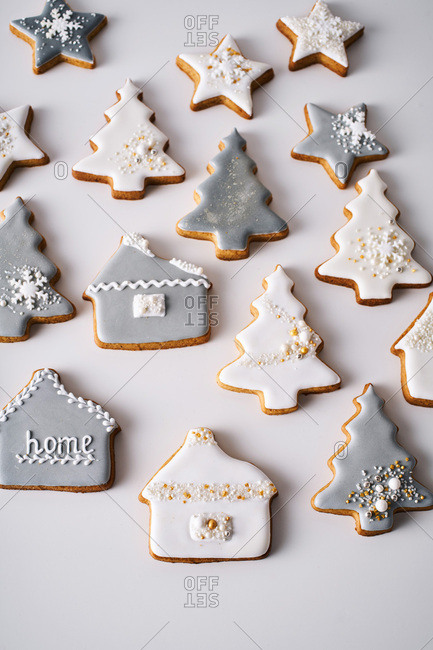 House and tree shaped decorated Christmas cookies