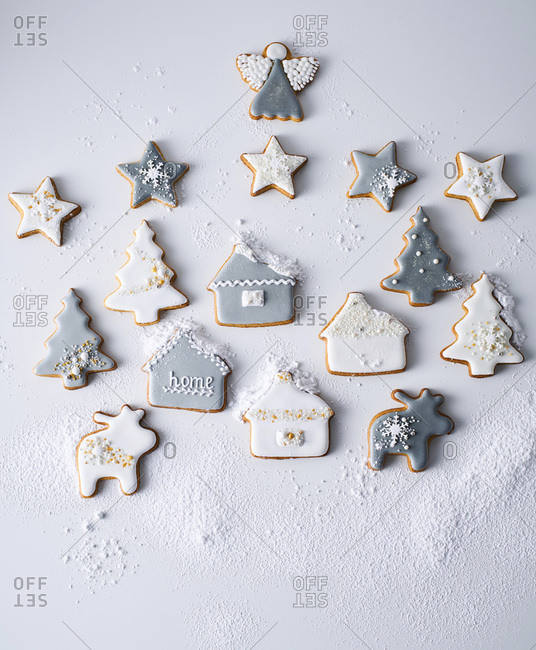 Christmas cookies arranged in a scene and dusted with powdered sugar
