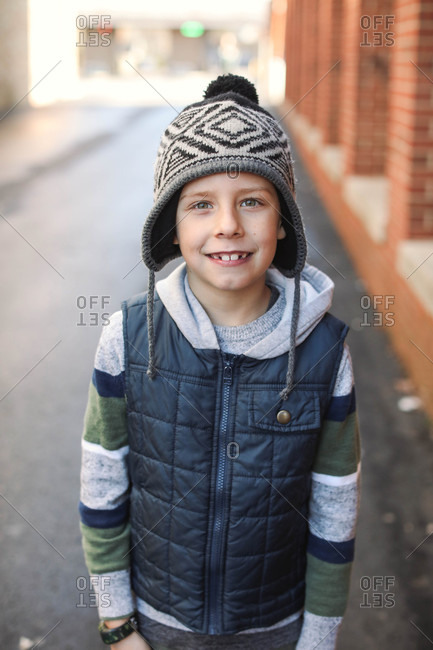 Portrait of a smiling boy wearing a knit hat