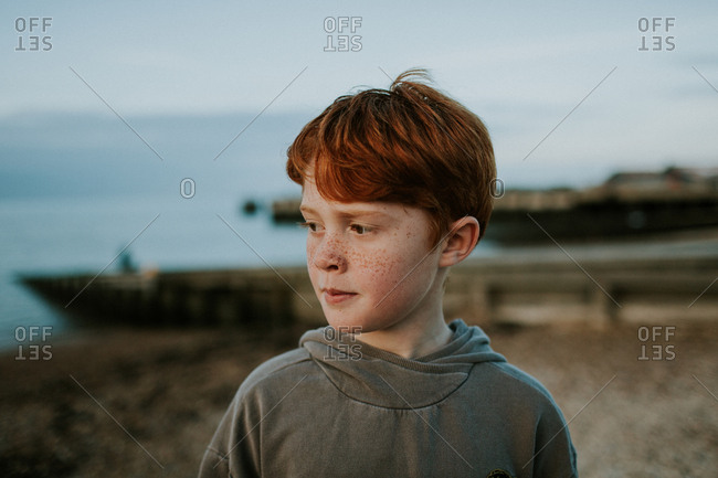 Portrait of a red-haired tween with freckles
