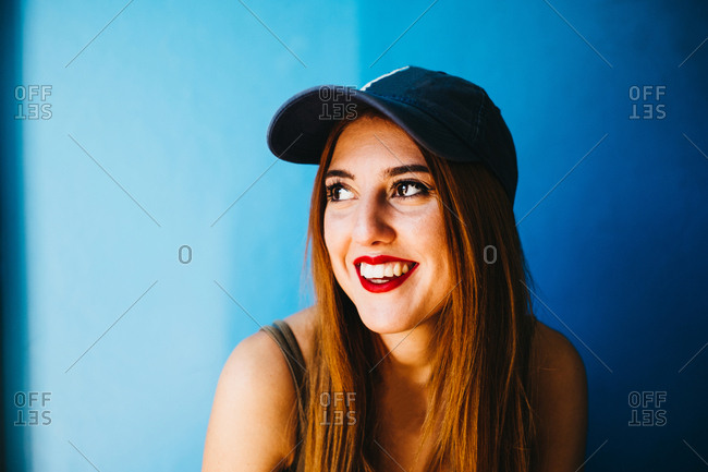 Smiling attractive lady in cap