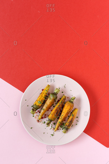 Healthy roasted carrots On colorful background. Flat lay. Top view. From above