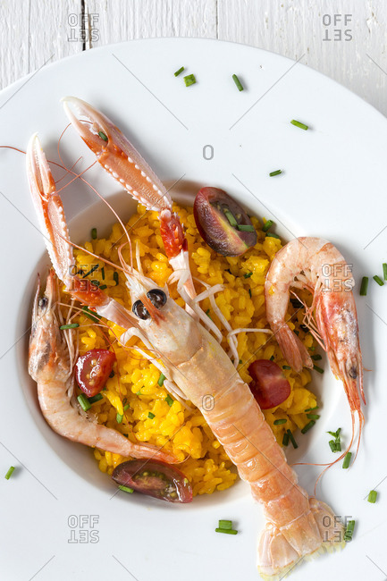 Homemade rice with crayfish and prawns. Flat lay. Top view. Paella. Typical. On white background