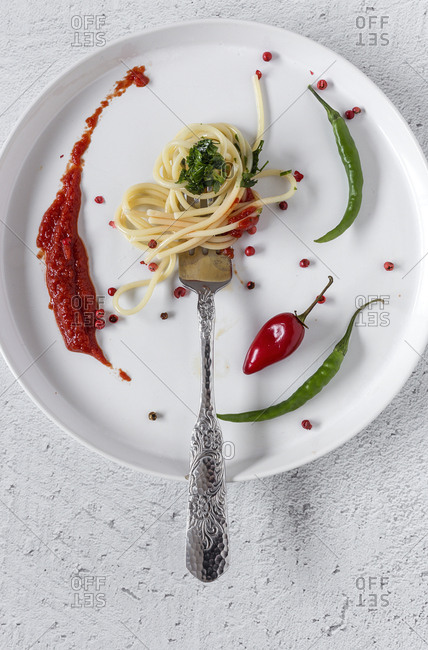 Spaghetti with tomato pesto and sauce. On white background. Flat lay. From above. Italian pasta