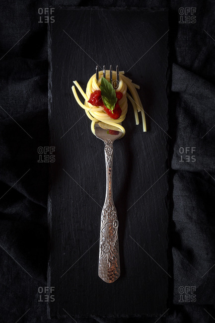 Spaghetti with tomato  sauce. On dark background. Flat lay. From above. Italian pasta