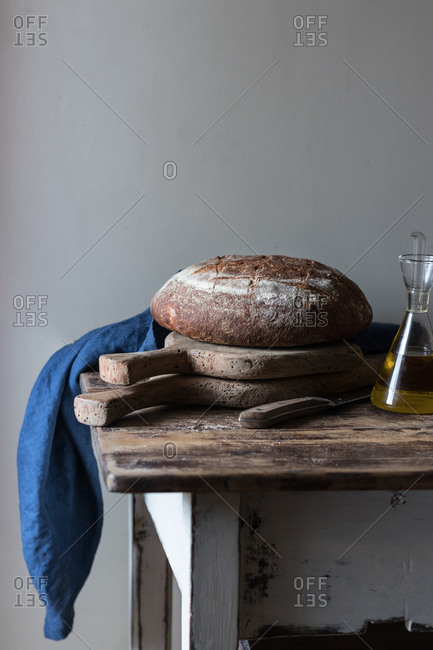 Oil and wholegrain bread on table