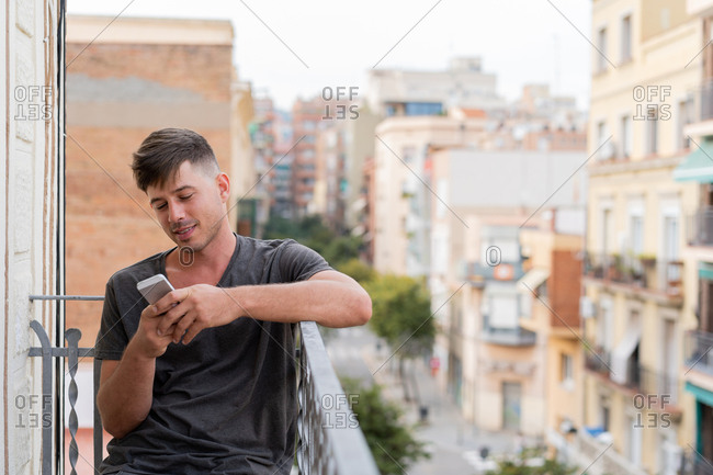 Man using phone outdoors