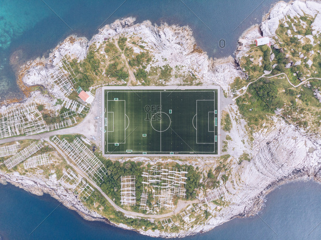 Drone view of square football field on rocky island of Lofoten, Norway