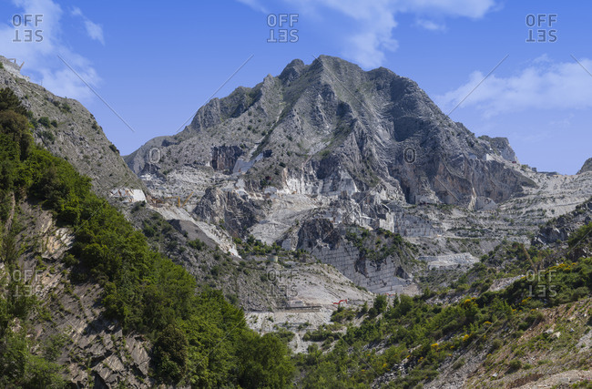 Magnificent view of majestic rock with marble quarry on sunny day in nature
