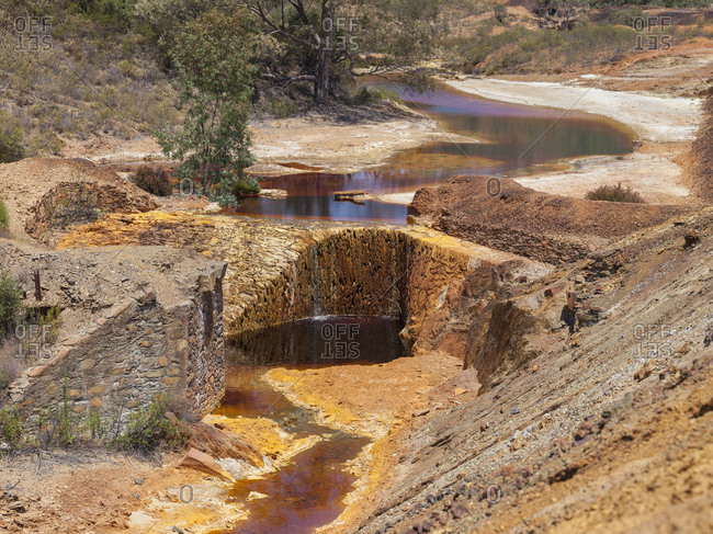 Huge puddles of dirty water in pits of Sao Domingos Mine in Portugal