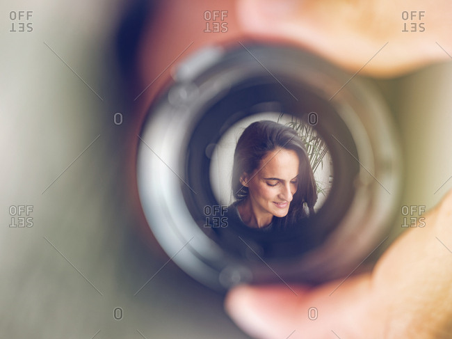 Reflection of woman in lens