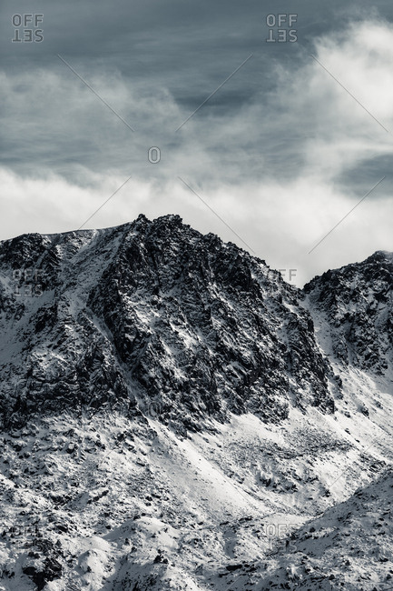 Dark cloudy skies over snow covered mountains in Andorra