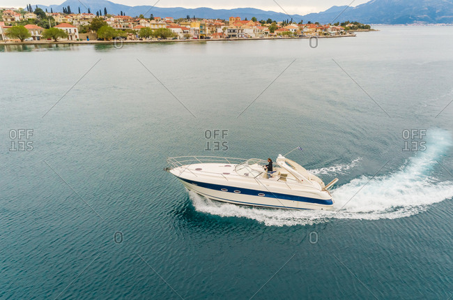 Aerial view of man making a turn with boat on the mediterranean sea., Achaia, Greece.