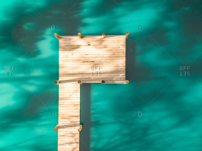 Aerial view of a wooden pontoon deck on the mediterranean sea.